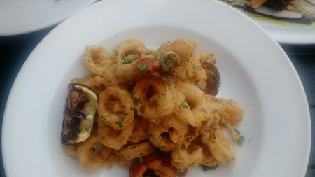 Crispy Baby Calamari: Lightly Fried, Milk Tenderized Calamari, Tossed with Cherry Peppers and Capers, Drizzled with Citrus Vinaigrette
